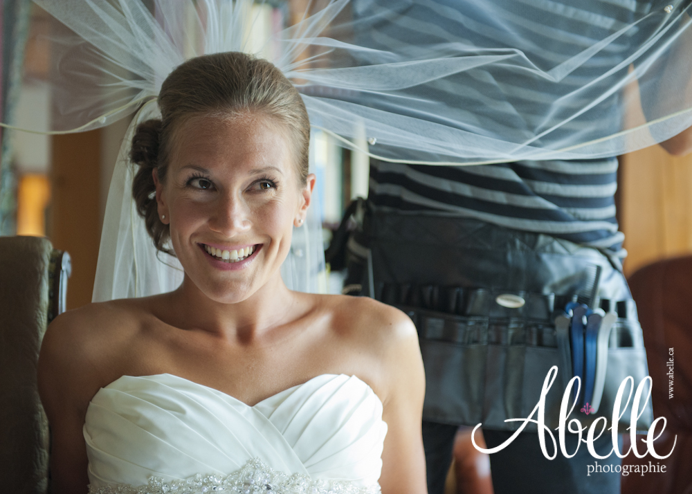 Smiling bride during the wedding veil setting.