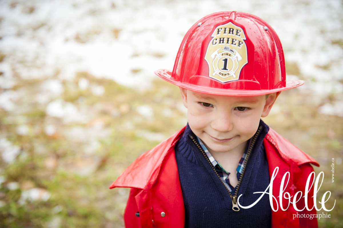Young child portrait in fireman outfit.