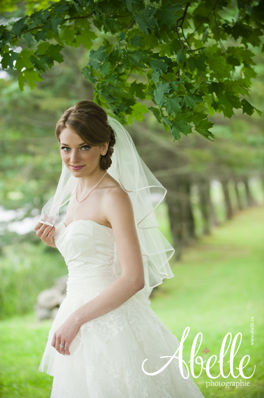 Outdoor portrait of bride in her wedding gown